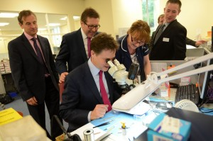 Nick Clegg tests out the equipment at Starkey Laboratories